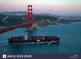 100 Shipping Containers San Francisco Container Ship And The Golden Gate Bridge At Dusk In The Stock