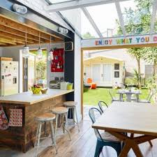 Inspiration For A Medium Sized Eclectic Kitchen Dining Room In London With Hardwood Flooring