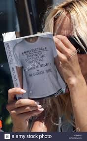 100 Pam Anderson House Ela At Her Beach House Reading A Book Entitled Stock