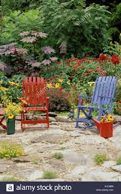 Whimsical Multi-colored Garden With Brightly Colored Outdoor Stock ... 65 Best Front Yard And Backyard Landscaping Ideas Designs Lets Do Whimsical Outdoor Ding Making It Lovely A Romantic Garden Wedding Every Last Detail Stevenson Manor Upholstered Side Chair With Turned Legs By Standard Fniture At Household Club Pair Vintage Rebar Custom Painted Vegetable Back Bistro Chairs 25 Patio To Buy Right Now Carate Batik Lagoon Rounded Corners Cushion Blue 6 Montage Antiques Display Of Counter Stool Jugglingelephants