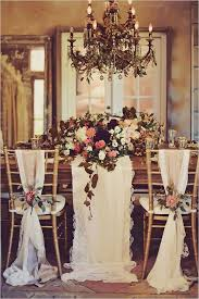 Maroon Pink Ad White Wedding Table Flowers And Gold Chairs With Linens Tied
