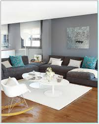 what color living room furniture goes with grey walls best