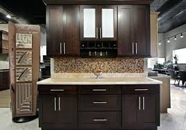 brown kitchen cabinets with light countertops wall color