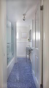 white bathroom with blue hexagon tile floor transitional
