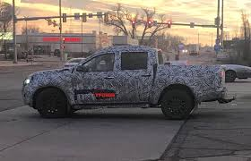 2019-nissan-frontier-spy-wheels-hitch-camo - The Fast Lane Truck