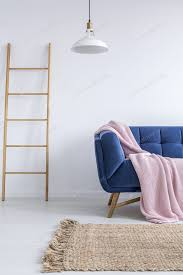 trendiges interieur mit blauem sofa foto bialasiewicz auf envato elements