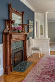 Example Of An Ornate Medium Tone Wood Floor Dining Room Design In Boston With Blue Walls