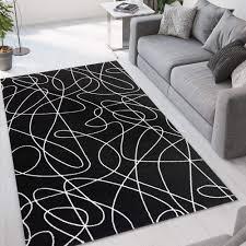wohnzimmerteppich modernes design schwarz weiß linien ner001