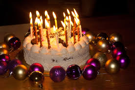 white birthday cake with candles