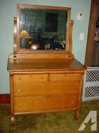 very nice antique solid tiger oak dresser with beveled mirror for