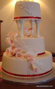 3 Tier white pillar wedding cake covered in sugar crystals and