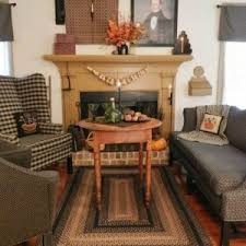 Primitive Living Room Wall Decor by Primitive Living Room With Wingback Chair And Dresser And Wooden