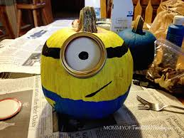 Minion Carved Pumpkins by Decorating And Painting Minion Pumpkins For Halloween