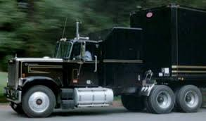 GMC Semi Hauling The F.L.A.G. Mobile Repair Unit From Knight Rider ...