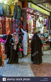 arab ladies shopping in the market place stock photo royalty free