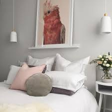 Contemporary Australian Bedroom With Large Galah Photography Artwork White Bedding Blush And Grey Scatter DecorInterior