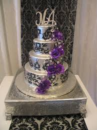4 Tier Wicked Chocolate Wedding Cake Iced In Silver Ganache Decorated With Black Fondant
