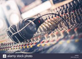 Mixer And Professional Headphones In The Recording Studio Sound Mixing Desk Mastering For Radio TV Broadcast