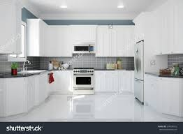 stock photo interior of new white kitchen with kitchenware and