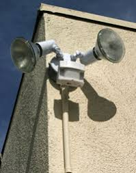How do motion sensing lights and burglar alarms work