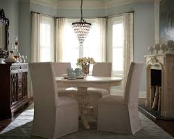 Emporium Round Dining Room Set (White) W/ Slipcover Chairs By ... Parson Chair Slipcovers Design Homesfeed Fniture Decorating Interesting Walmart For Covers Ding Chairs Armchair Covers Set Beautiful Room Argos Pott Charming Habitat Why I Love My White Slipcovered House Full Of Summer Cisco Brothers Parsons Denim Cotton Feather Down Slip Cover Patterns Tufted Home Target Image Australia Counter Height Stool Kitchen Slipcover Elegant For Stylish Look