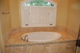 Tiling A Bathtub Deck by Oval Drop In Tub Bathroom Traditional With Accent Tile Deck