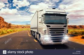 100 Valley Truck And Trailer Freight Truck On Road In Valley Front View Heavy Traffic