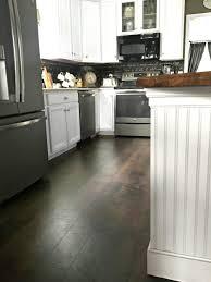 best waterproof laminate flooring laying around kitchen units is