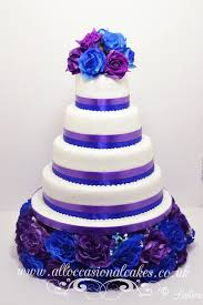 blue and purple themed wedding cake from £ 260