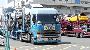 Car Carrier Trucks Offloading At Japanese Car Auction - Japanese Car ...