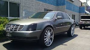 deville on 24s 2010 Cadillac DTS on 26
