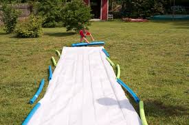 Make A DIY Slip And Slide | DIY Network Blog: Made + Remade | DIY More Accurate Names For The Slip N Slide Huffpost N Kicker Ramp Fun Youtube Triyaecom Huge Backyard Various Design Inspiration Shaving Cream And Lehigh Valley Family Just Shy Of A Y Pool Turned Slip Slide Backyard Racing With Giant 2010 Hd Free Images Villa Vacation Amusement Park Swimming 25 Unique Ideas On Pinterest In My Kids Cided To Set Up Rebrncom Crazy Backyard Slip Slide