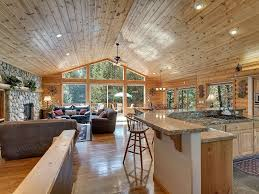 Living RoomRustic Large Window Room Decor With Textured Wood Floor And Small Kitchen