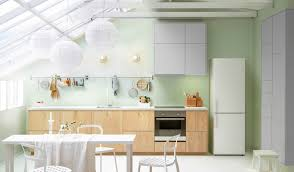 Open Bright Kitchen Space With IKEA Cabinets Dining Table And Chairs