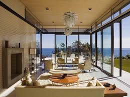 fabulous living room surrounded by view with beige sofa fireplace