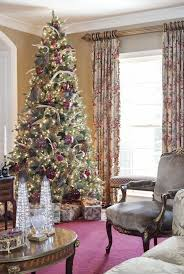 Very Rich And Tall Christmas Tree Wrapped In Oversized Ornaments