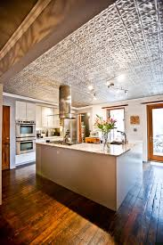 faux tin ceiling tiles kitchen rustic with brick stained wood