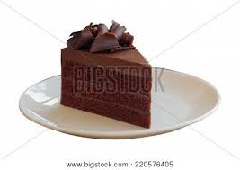 Triangle shape slices piece of dark chocolate fudge cake topping with chocolate curl on white plate