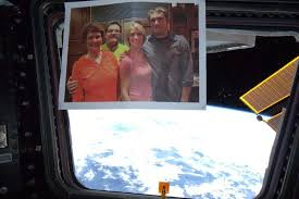 A Picture Of Me And Fam Taped To The Window International Space Station