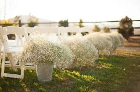 Something About These Simple Arrangements For Ceremony Aisle Decor Just Screams Rustic Simplicity While Adding A Beautiful Touch Of Bridal White