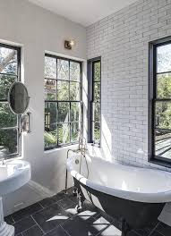 black and white vintage bathroom with black claw foot bathtub