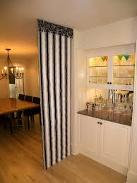 Varnished Wood Floor Tile With White Stain Kitchen Cabinets Dark Brown Granite Counter Tops And Black Striped Pattern Curtain Room Divider