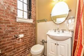 exposed brick bathroom traditional bathroom new york by