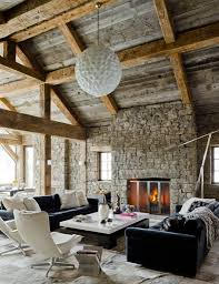 Ball Shaped Chandelier With Cultured Stone Fireplace And Black Leather Sofa For Modern Rustic Living Room Ideas