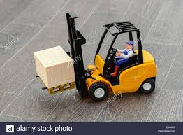 100 Toy Forklift Truck A Toy Forklift Truck And Driver Studio Shot With A Grey Vinyl