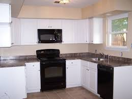 Facelift Off White Cabinets With Black Appliances