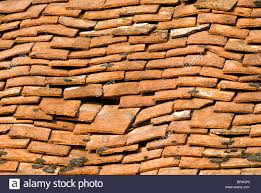broken clay roof tiles on house stock photo royalty