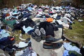 piles of clothes and shoes dumped in carlton street near bolton