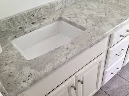 andromeda white granite vanity top on a medallion columbia