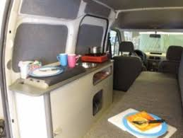 The Kitchen And Sofa Bed In A Mini Camper Van Conversion